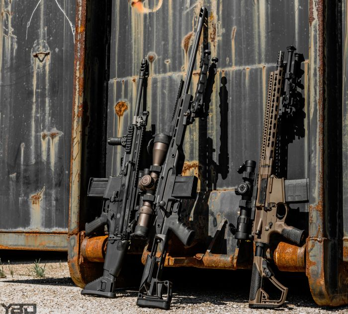 A 308 line up.  From left to right: FN SCAR 171s, Rainier Arms Precision Rifle, and Daniel Defense DD5v1.