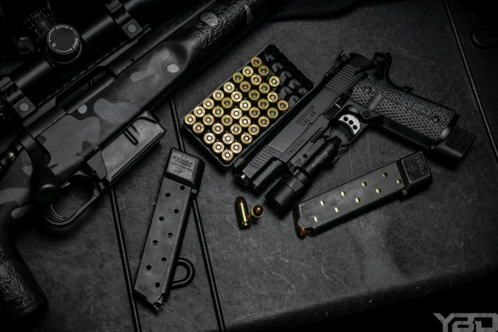 Springfield TRP 1911 with Surefire X-300u light getting loaded up.