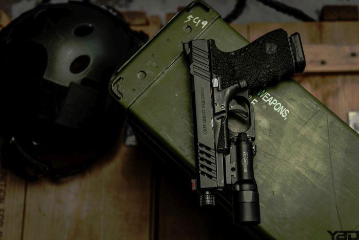 Grey Ghost Precision Gen 4 Glock 19 with Surefire X-300u light.