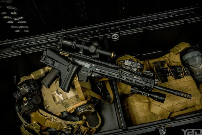 A Bronc Box filled with tactical gear and a Bushmaster ACR.