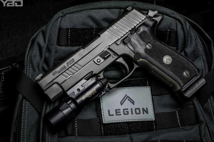 A Sig Sauer P229 Legion with Surefire X-300u light.