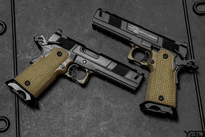 Two STI COSTA Carry COMP 2011s in 45ACP and 9MM.