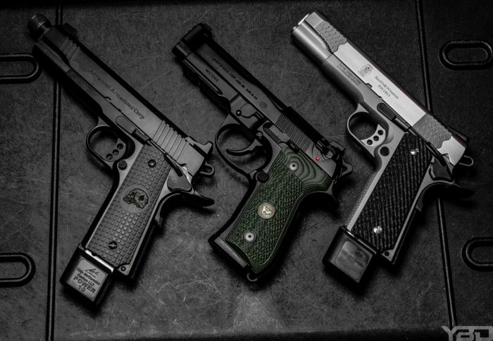 A Remington R1 Enhanced 1911, Wilson Combat Beretta 92G, and a Smith and Wesson E-Series 1911