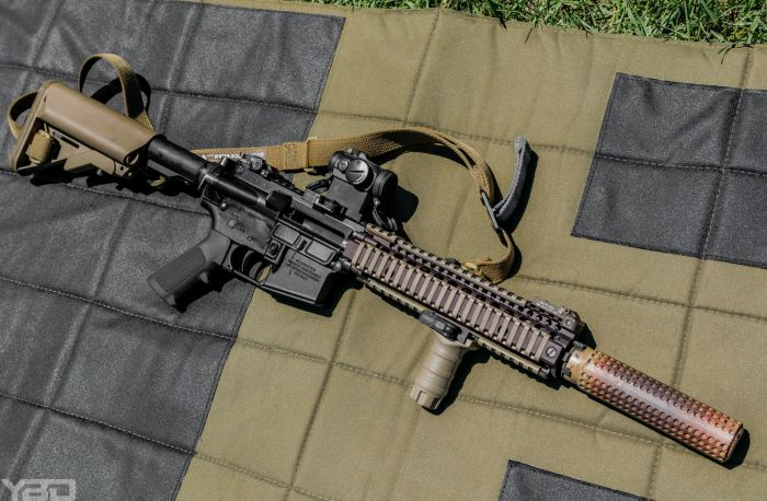 A MK-18 with Aimpoint T-2 red dot and Knights Armament Company (KAC) suppressor.