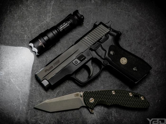 A perfect EDC consisting of a Sig Sauer P225, Rick Hinderer XM-18 Fatty Harpoon Tanto folding knife, and Surefire Defender flashlight.
