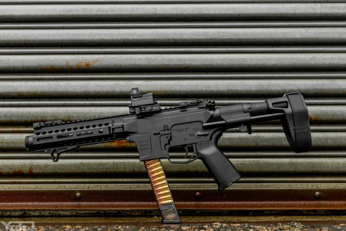 A Palmetto State Armory PA-X9 9MM AR with SB Tactical PDW Brace and Vortex Optics RAZOR mini red dot.