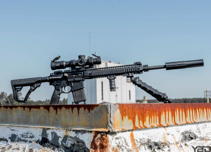 A Daniel Defense MK12 with Gemtech ONE suppressor providing rooftop security.