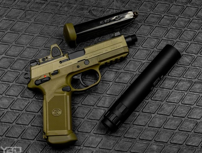 A FNX-45 Tactical with Trijicon RMR and Gemtech GM-45 suppressor.