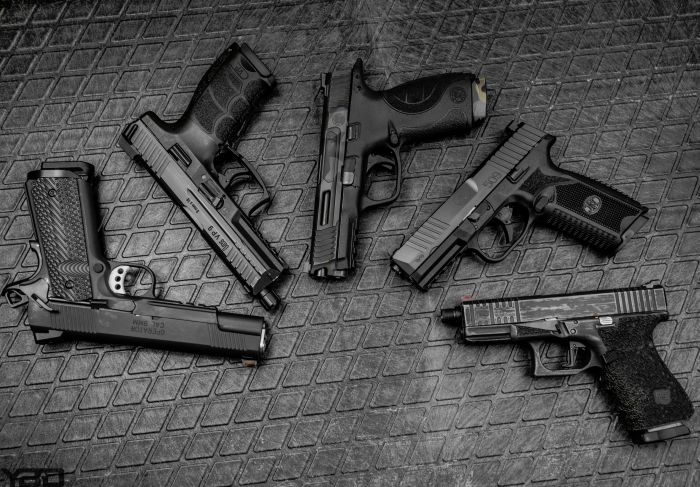 Which 9MM handgun would you choose?  From left to right:  Springfield Armory Range Officer Operator, HK VP9LE, S&W M&P9, FN-509, or a Glock 19 Gen 4.