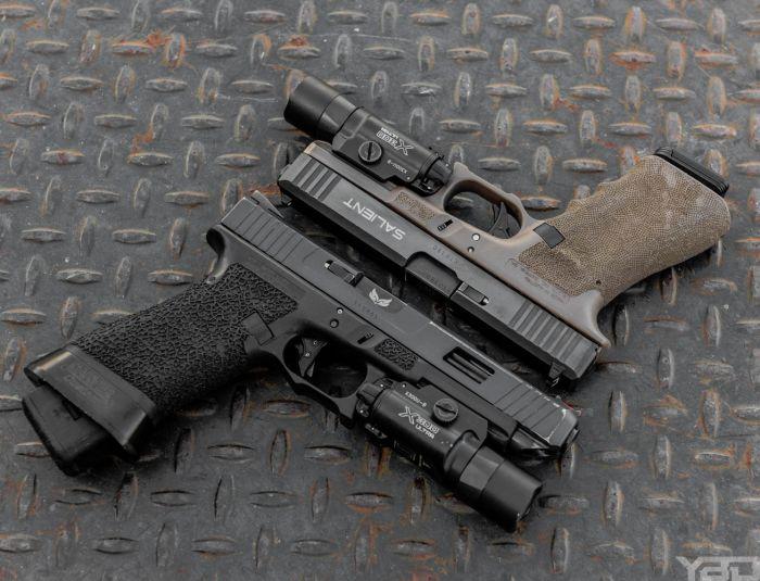 A couple of gunfighter Glocks. Bottom: A custom Glock 34 Gen 3 Top: A Salient Arms International Glock 17 Gen 3
