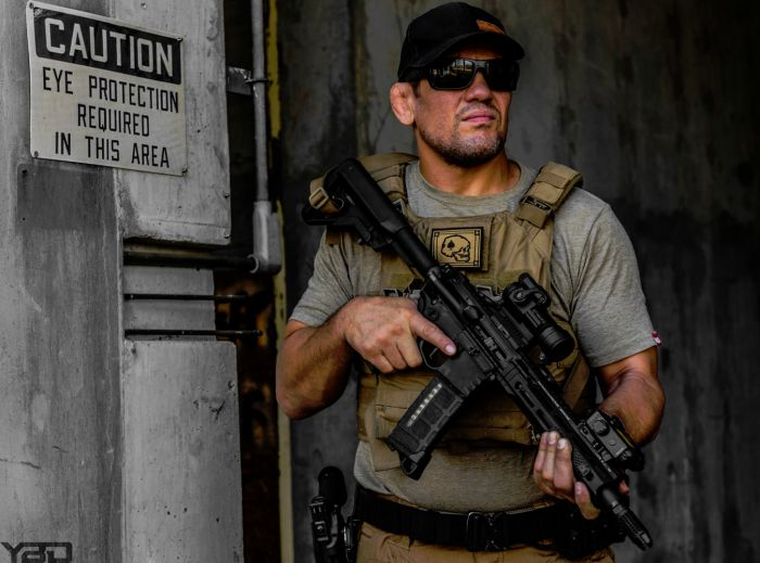 Our Defensive Tactics Instructor Jason Kelly rocking a Daniel Defense/Cross Machine Tool SBR with Aimpoint PRO red dot and US Night Vision laser aiming device.