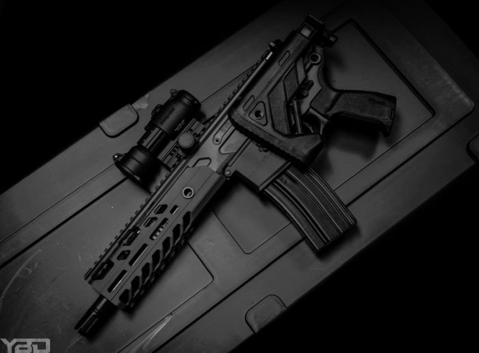 A Sig Sauer MCX Virtus SBR with Aimpoint PRO red dot.