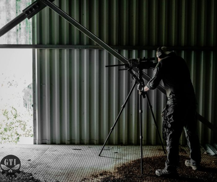 Sniper students practice from firing deep inside an urban setting.