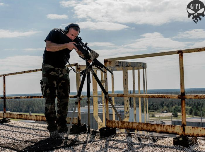 Sniper students practicing high angle elevated shooting while on the roof top of our sniper tower.