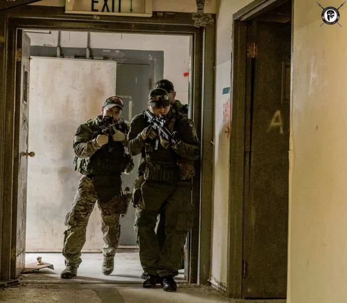 Students getting ready to enter a room during our CQB class.