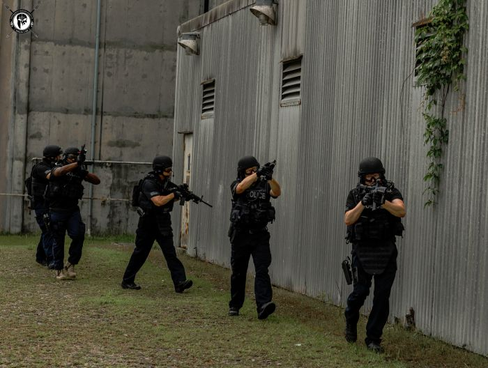 SWAT Officers practicing tactical movements outside of the target structure.