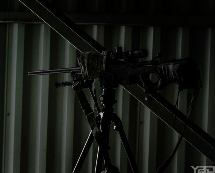 A sniper sutdents precision rifle tucked away inside our sniper tower getting ready to ring some steel.