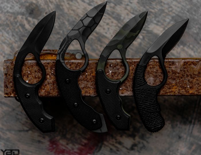 Four Colonel Blades knives all lined up in a row.