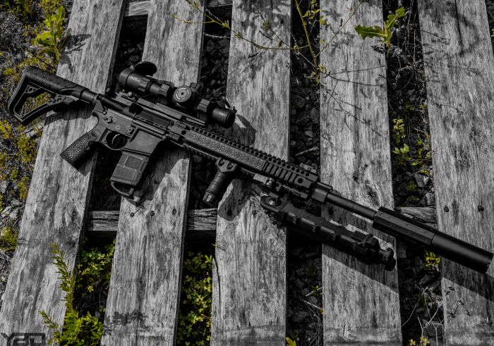 A Daniel Defense MK12 with Gemtech ONE Suppressor, Accu-Tac bipod, and a Primary Arms 1-8 ACSS optic on-top.