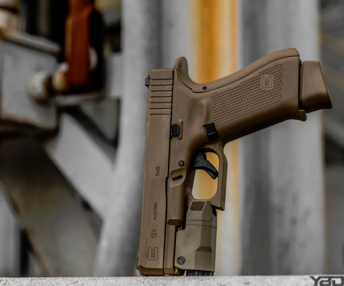 A Glock19X with Inforce APLC weapon light.