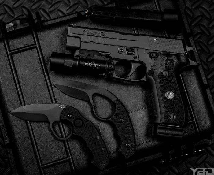 My Sig Sauer P226 Legion with a Colonel Blades NCO and folding knife by its side.