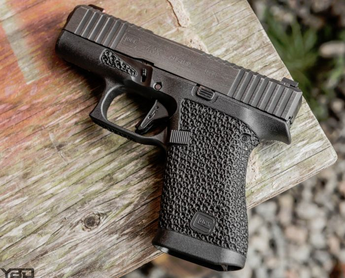 A custom Glock 43X with custom stippling from GNP Tactical.