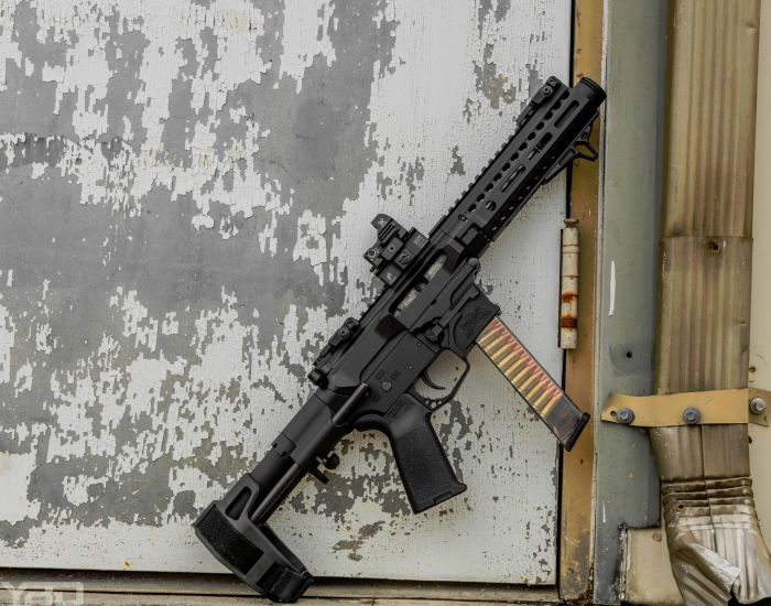 A Palmetto State Armory AR9 with SB Tactical PDW brace, a Vortex Optics RAZOR red dot, and an ETS clear Glock magazine loaded up with some 115gr 9MM ammo.