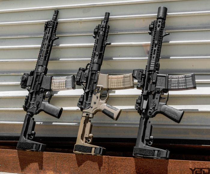Three custom AR Pistols all lined up ready for some range time.