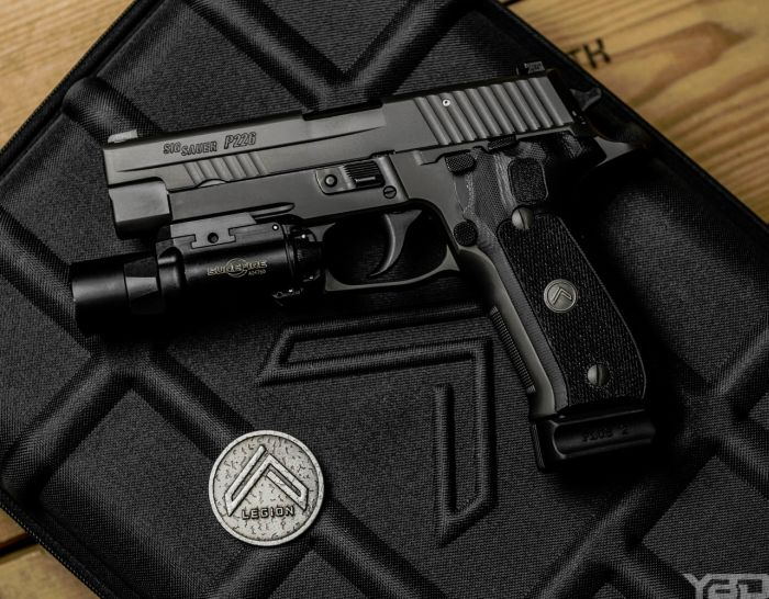 The Sig Sauer P226 Legion is basically the Ferrari of pistols.  You can't beat perfection straight from the factory.