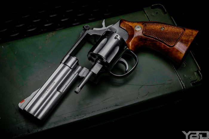 There is just so much beauty in a nice revolver with wood grain grips.  Just like this S&W 686.