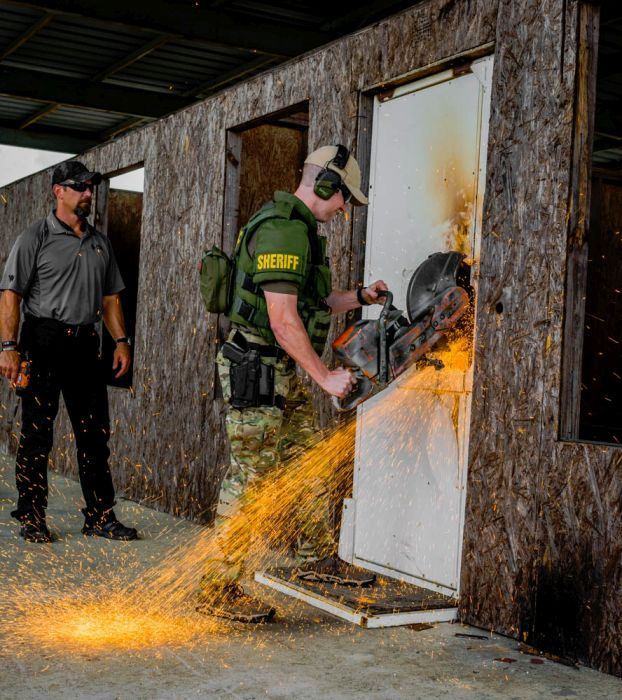 A Sheriff Deputy practicing breaching with the quickie saw during our Tactical Breaching Course.