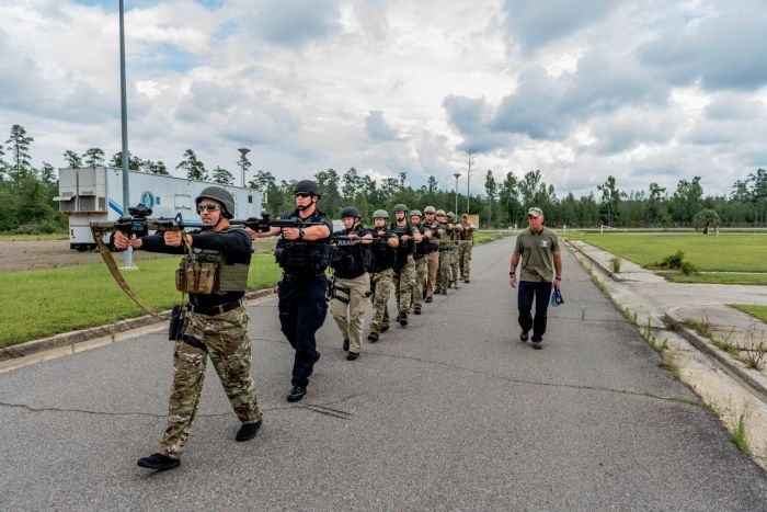 Doing a little PT while moving to the training area during our Basic SWAT Course.