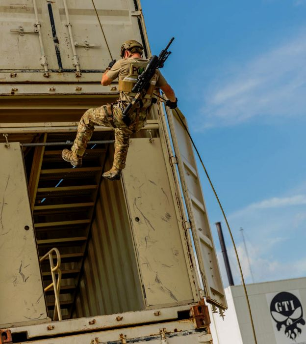 A SWAT Sniper rappelling down our 4-story rappel tower.