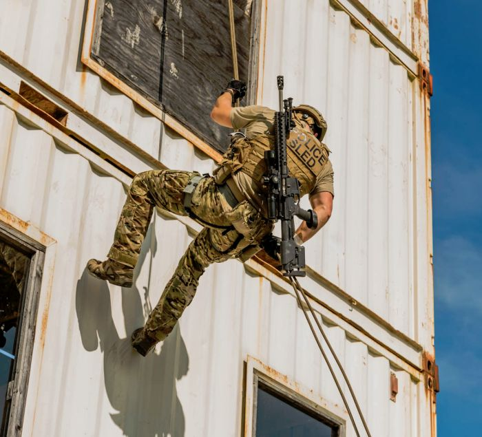 Another SWAT Sniper moving around the obstacles on our rappel tower.