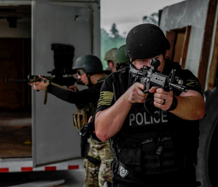 SWAT Operators practicing movements outside the target structure during our Basic SWAT Course.