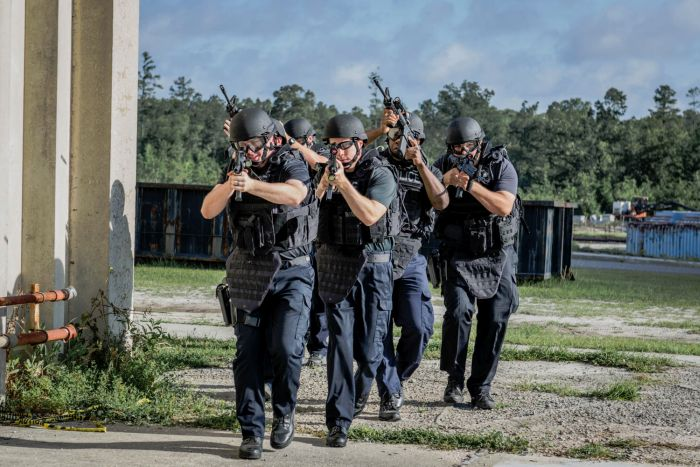 SWAT Operators moving outside the target structure.