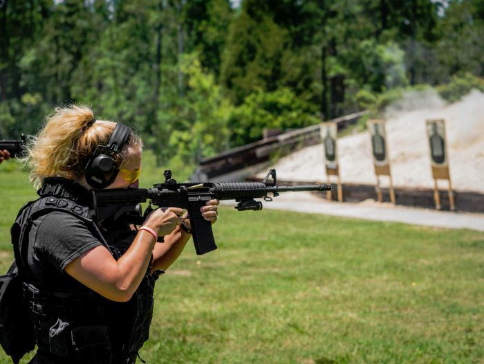 A Female SWAT Operator engaging targets during our Basic SWAT Course.