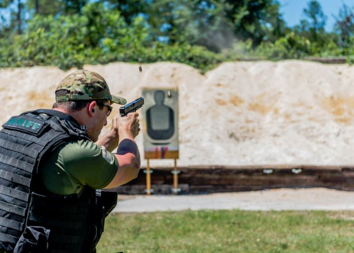 A SWAT Operator transitioning to his side arm during some live fire training during our Basic SWAT Course.