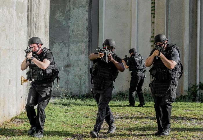 SWAT Operators advancing towards the breach point.