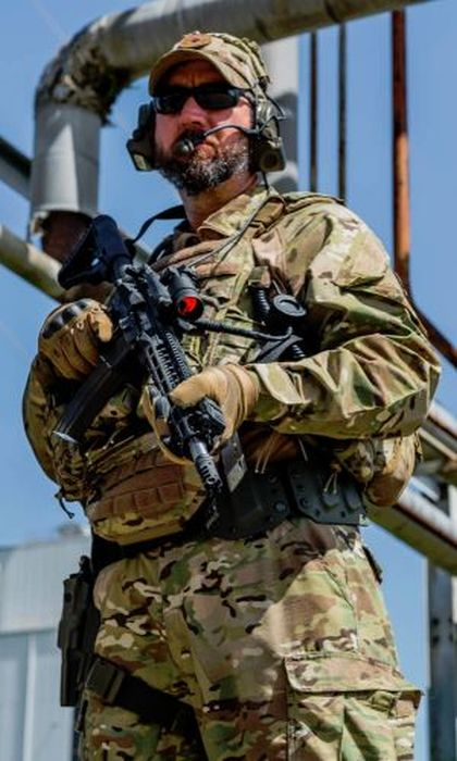 Tactical Instructor JT Timmins all geared up for GTI's photoshoot with Aimpoint.