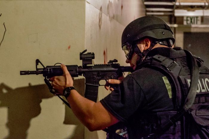 A SWAT Operator coving the hallway inside our fully decommissioned nuclear facility.