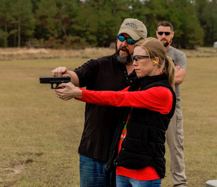 GTI Vice President Brian Naillon teaching basic pistol sight alignment sight picture during a Corporate Team Building Event hosted at GTI.