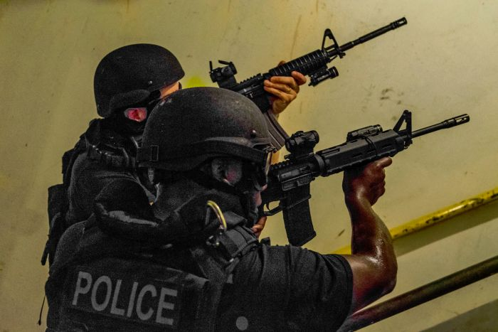 Two SWAT Operators covering the stairs during some CQB training.