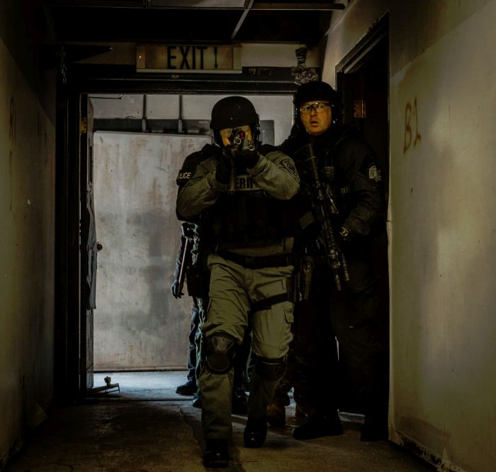 SWAT Operators moving room to room during their final exercise during our Tactical Breaching Course